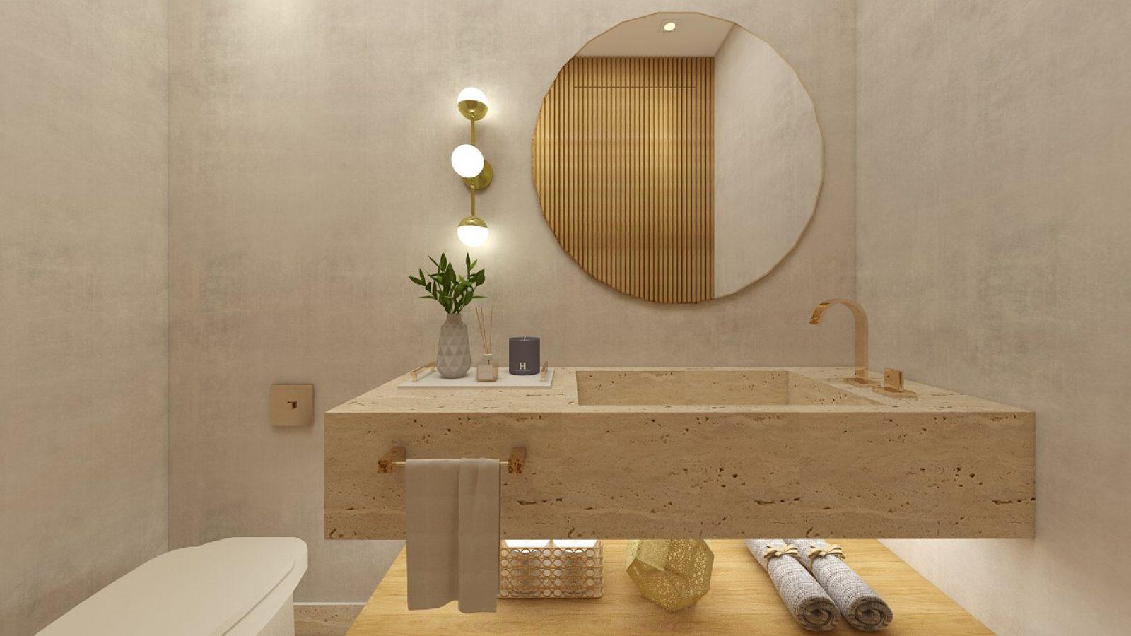 Banheiro com lavabo, espelho redondo e planta sobre a pia.