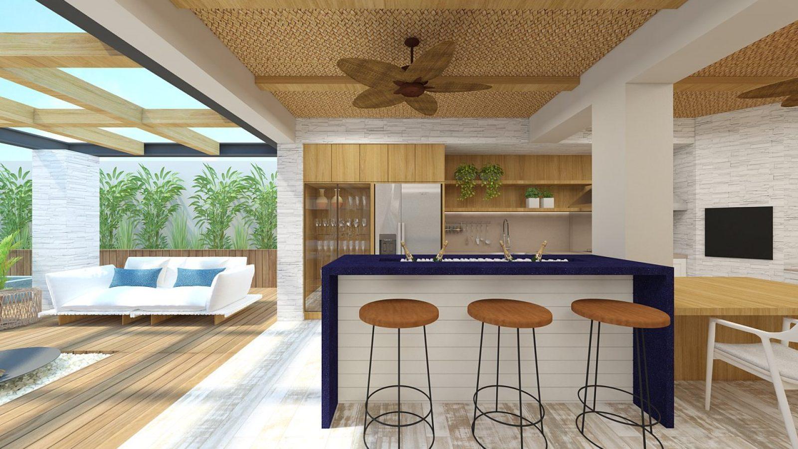 Interior de casa com piso de madeira, balcão azul, com banquetas e sofá branco. Ventilador no teto.