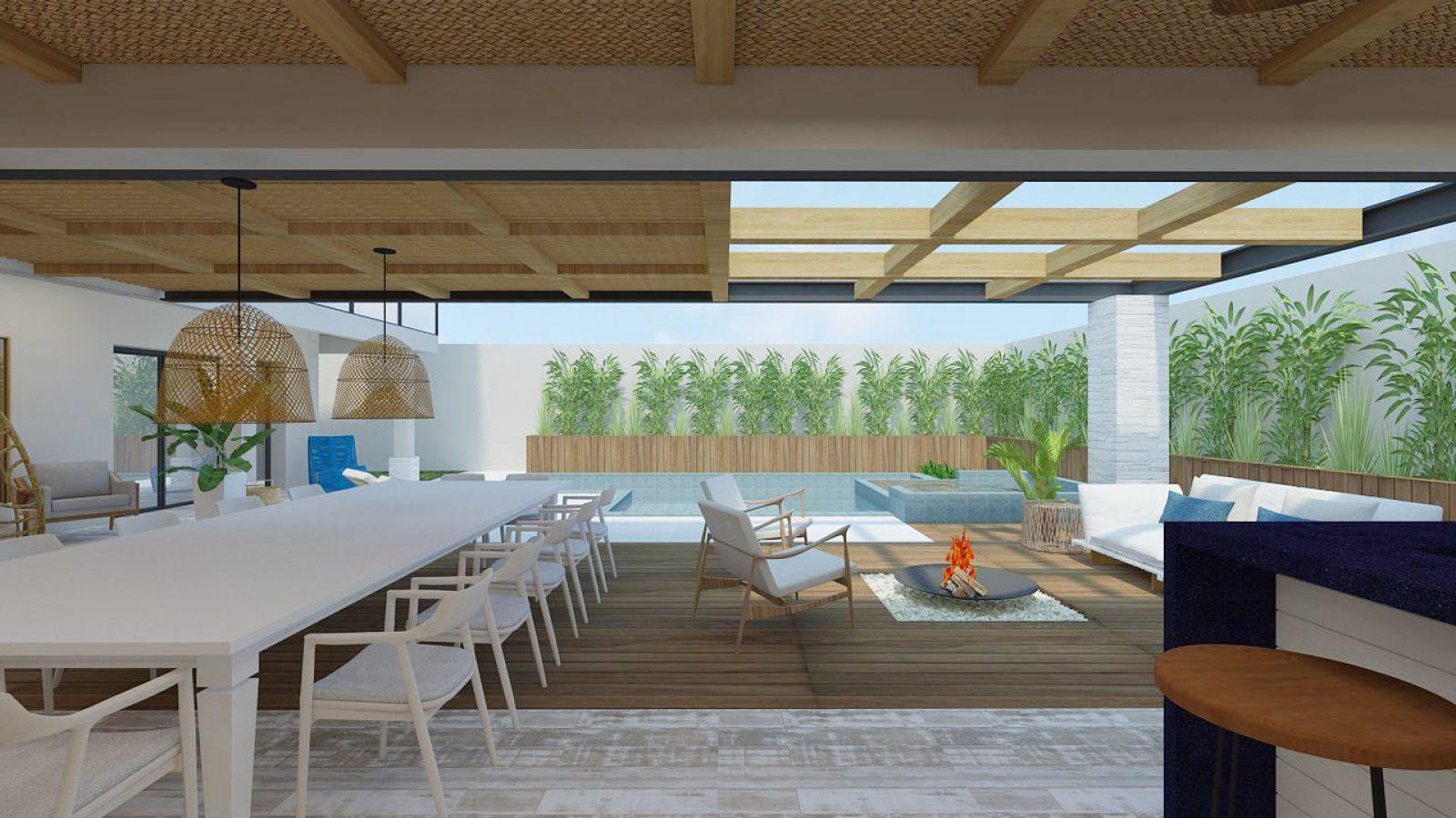 Interior área da piscina, com piso de madeira, mesa e cadeiras brancas.