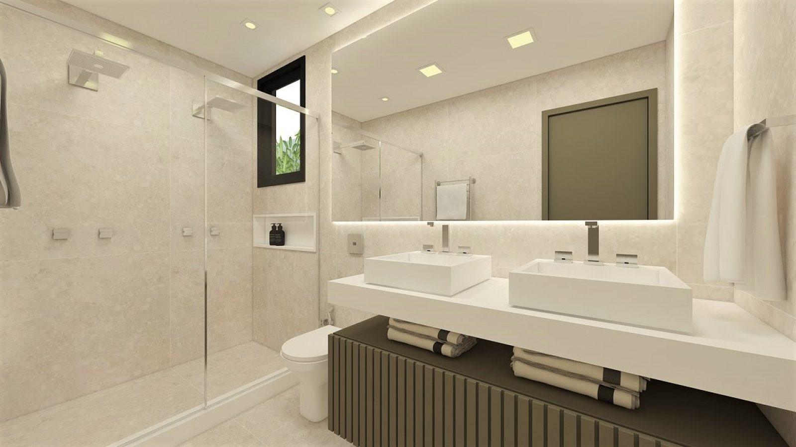 Banheiro com duas pias e área de banho, com acabamento na cor branca.